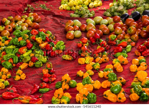 West Africa Gambia Banjul Serrekunda Albert market  - peppers of different colors presented at a street stall