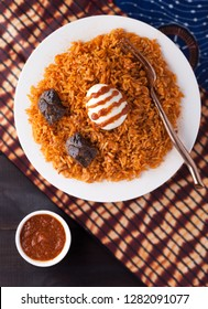 West Africa Rice Jollof Dish with Boiled Egg and Beef