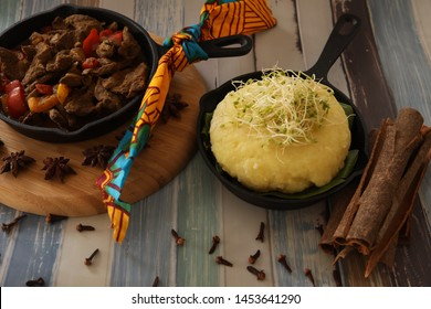 West African Beef With Plantain Fufu Presented on a Table