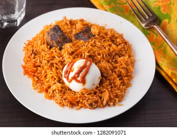 West African Cuisine of Rice Jollof with Boiled Egg and Beef