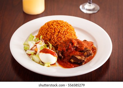 West African Dish of Jollof Rice with Fish and Boiled Egg