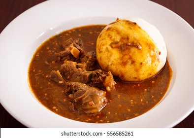 West African Dish of Okra Soup with Goat and Banku