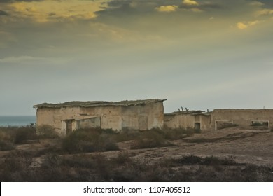 The West Bank, the border zone between Israel and Jordan, the ruins of barracks and military facilities, barbed wire.