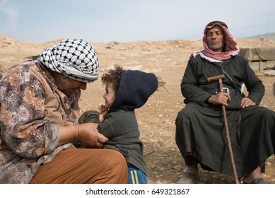 WEST BANK - JANUARY 22: Elderly residents and a child remain in the Jordan Valley village of Kirbet Makhoul, West Bank, which as been twice demolished by the Israeli army, January 22, 2014.