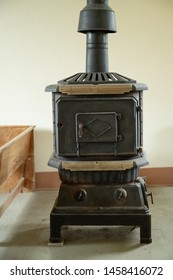 West Branch, Iowa, USA July 13, 2019, Wood stove in historic Friends meetinghouse where president Herbert Hoover's family attended Quaker services