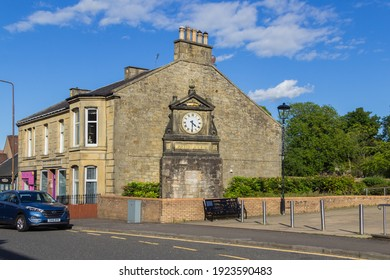 West Calder, Scotland - 06 June 2020: West Calder Co-Operative Clock, a memorial to  Burngrange Disaster in January 1947 where 15 miners died in a pit after an underground explosion and fire.