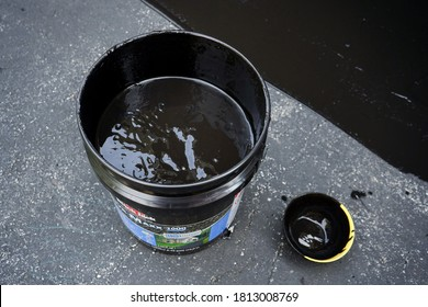 """""""West Chester,PA /USA - August 20 2020 :bucket of black tar for sealcoating driveway"""