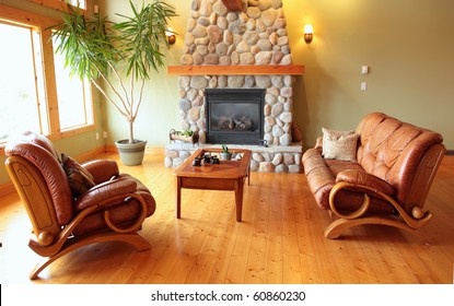 A west coast living room with a river rock fireplace.