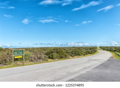 WEST COAST NATIONAL PARK, SOUTH AFRICA, AUGUST 20, 2018: A landscape in the West Coast National Park near Langebaan on the Atlantic Ocean coast of the Western Cape. A directional sign is visible