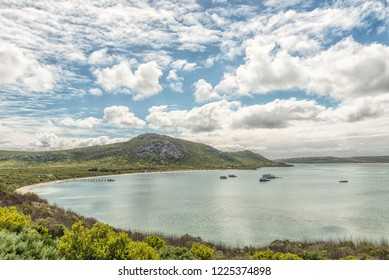 WEST COAST NATIONAL PARK, SOUTH AFRICA, AUGUST 20, 2018: A view of Kraalbaai at the Langebaan Lagoon on the Atlantic Ocean coast in the Western Cape Province. A jetty and houseboats are visible