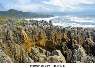 West Coast, New Zealand's main tourist attraction - the spectacular Punakaiki Rocks (Pancake Rocks) on a stormy day in Spring.