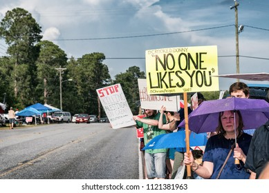 West Columbia, South Carolina - June 25, 2018: Anti-Trump protesters protest the arrival of Donald Trump in West Columbia before his rally with South Carolina Governor Henry McMaster.