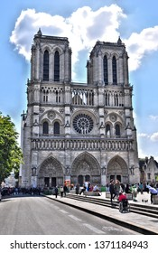 West facade of Notre Dame cathedral (damaged in 2019 fire). Cathedral is most recognized symbol of Paris and is most visited monument in Paris, France. Photo taken 2014-05-03.