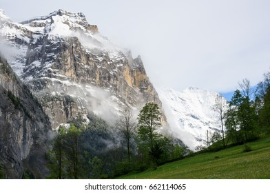 The west flank of the Jungfrau towering over the Lauterbrunnen valley, with the snowy peak of the Breithorn in the distance.