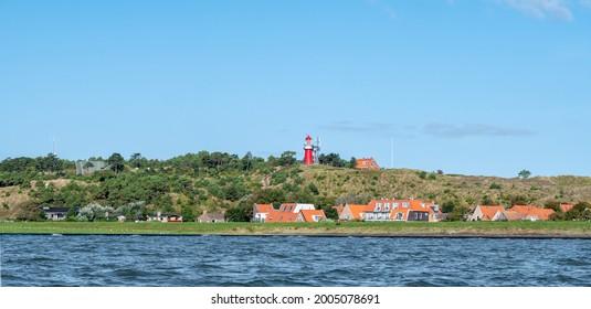 West Frisian island Vlieland with Vuurduin lighthouse on vuurboetsduin and East-Vlieland town from Wadden Sea, Friesland, Netherlands