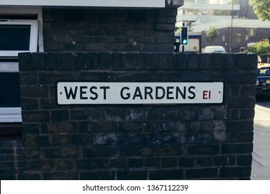 West Gardens Street name sign against brick wall, Wapping. Wapping is a district in East London.