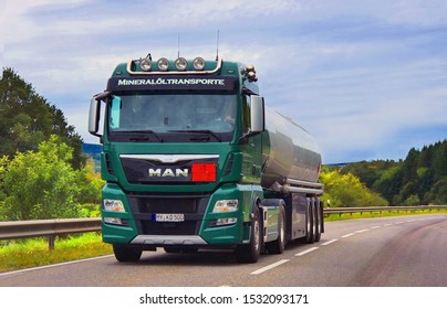West Germany. Land near Weisbaden .   24.09.2019. A green tanker is transporting cargo on a highway. - Image