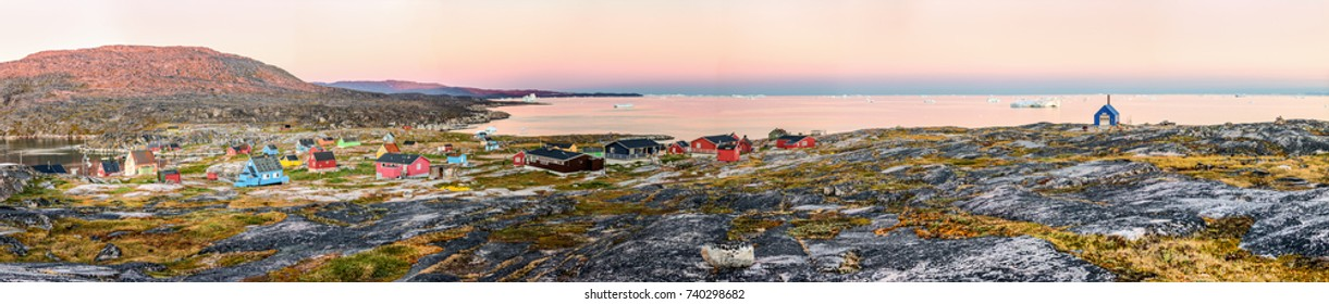 West Greenland. Panorama of Disko Bay with icebergs near Oqaatsut village. Source of icebergs is by the Jakobshavn glacier. This is a consequence of global warming and catastrophic thawing of ice