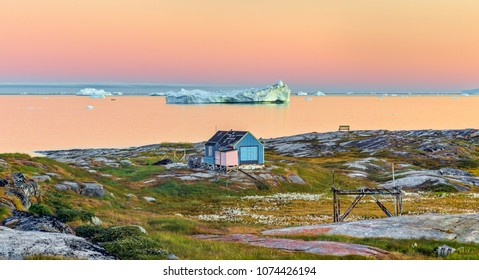 West Greenland. View of Disko Bay with icebergs from the village Oqaatsut Midsummer Night. The source of these icebergs is the Jakobshavn glacier