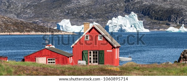 West Greenland. View of Disko Bay with icebergs from the village Oqaatsut in the early morning. The source of these icebergs is the Jakobshavn glacier