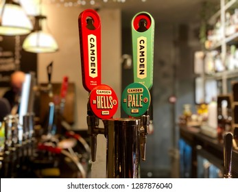 WEST HAMPSTEAD, LONDON - JANUARY 13, 2019: Camden Town Brewery beer taps inside a pub in West Hampstead, North London, UK.
