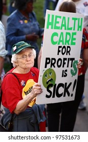 "WEST HARFORD, CT - A unidentified woman with a sign reading ""HEALTH CARE FOR PROFIT IS SICK"" at a town hall meeting on health care reform led by Rep. John B. Larson in West Hartford, CT on September 2, 2009."