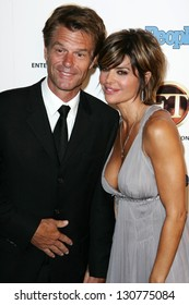 WEST HOLLYWOOD - AUGUST 27: Harry Hamlin and Lisa Rinna at the 10th Annual Entertainment Tonight Emmy Party Sponsored by People in Mondrian August 27, 2006 in West Hollywood, CA.