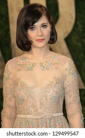 WEST HOLLYWOOD, CA - FEB 24: Zooey Deschanel at the Vanity Fair Oscar Party at Sunset Tower on February 24, 2013 in West Hollywood, California