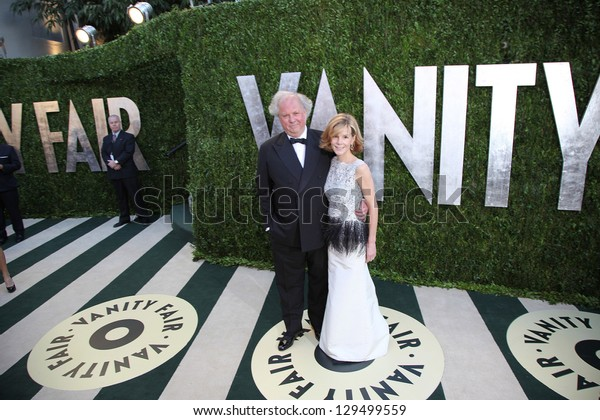 WEST HOLLYWOOD, CA - FEB 24: Graydon Carter, wife Anna at the Vanity Fair Oscar Party at Sunset Tower on February 24, 2013 in West Hollywood, California
