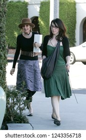 West Hollywood, CA, USA, 03-13-2007 Diane Keaton and friend out shopping wearing a brown hat and belt.
