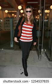 West Hollywood, CA, USA, 05-23-2007 Carmen Electra out shopping in a red and white striped top.