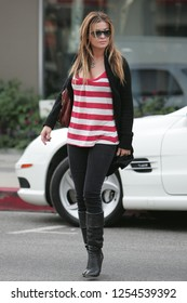 West Hollywood, CA, USA, 05-23-2007 Carmen Electra out shopping in a striped top.