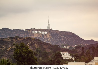 West Hollywood, California / USA - Nov 10, 2014: View of the famous Hollywood sign, cross and Los Angeles mountains in southern California.