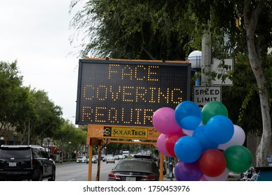 West Hollywood, CA/USA - June 5, 2020: Despite days of Black Lives Matter protests on the streets, a road sign still reads Face Covering Required for coronavirus