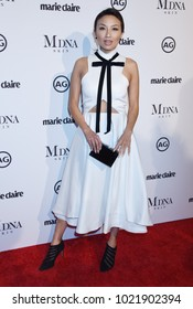 """WEST HOLLYWOOD - JAN 11:  Jeannie Mai arrives to the 2018 Marie Claire """"Image Makers Awards""""  on January 11, 2018 in West Hollywood, CA"""
