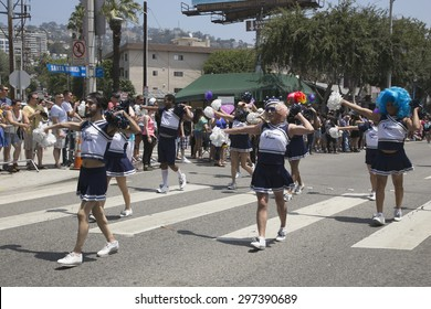 West Hollywood, Los Angeles, California, USA, June 14, 2015, 40th annual Gay Pride Parade for LGBT Community, down Santa Monica Blvd., males dressed as cheerleaders march in parade