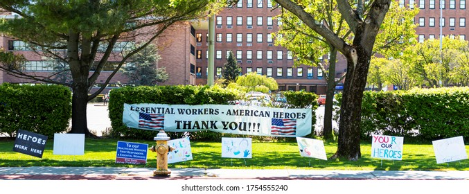 West Islip, New York, USA - 13 May 2020: Signs thanking the nurses, doctors and all essential workers in front of Good Samaritan Hospital during COVID-19 outbreak.