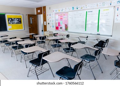 West Islip, New York, USA - 3 June 2020: A high school classroom with empty desks and no students due to coronavirus pandemic lockdown.