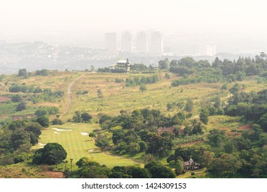 West Java, Indonesia - April 27, 2019: View of the golf course from above, Puncak, Bogor, Indonesia.