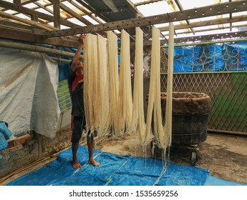 West Kalimantan, Indonesia-Feb 20, 2019:Unidentified local workers processing and hanging the rice egg noodles inside the traditional factory before sell is for local consume.
