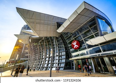 WEST KOWLOON, HONG KONG - SEP 29, 2018: Main entrance of West Kowloon High Speed Rail Station in Hong Kong operated by MTR. The station is a modern architecture with curvy and glass facade.