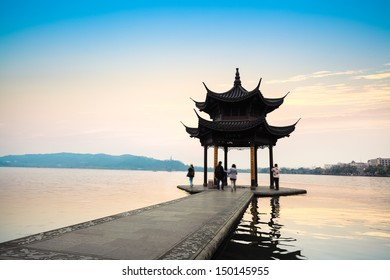 the west lake scenery with ancient pavilion at dusk in hangzhou,China