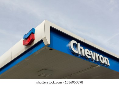 West Linn, Oregon - Mar 5, 2019: The Chevron sign at a Chevron gas station. Chevron Corporation is an American multinational energy corporation.