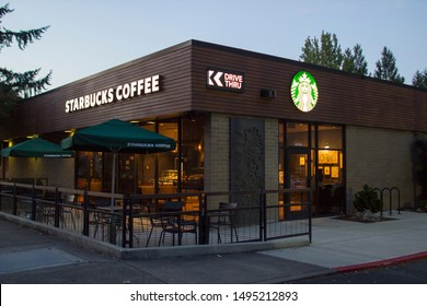 West Linn, Oregon, USA - Aug 30, 2019: A Starbucks Coffee shop in the evening.