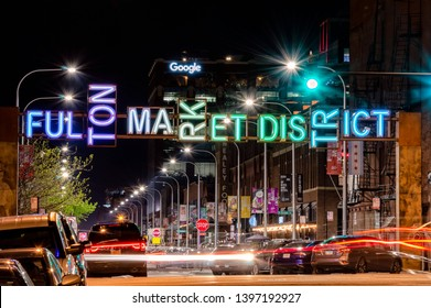 West Loop, Chicago-May 13, 2019: Fulton Maket District gateway at night with long exposure light trails. Main street in Chicago, Illinois.