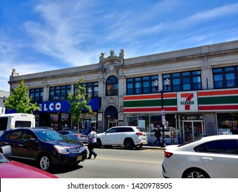 West New York, NJ - May 18 2019: A historic building on Bergenline Avenue with an ornately decorated crest, with a Telco and 7-Eleven on the ground floor
