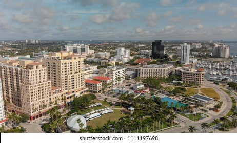 WEST PALM BEACH, FL - APRIL 10, 2018: Aerial city skyline from lake on a wonderful sunny day. The city is a major attraction in Florida.