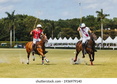 WEST PALM BEACH, FL - MARCH 14, 2021: Coca Cola plays the ball against Pilot polo team during the USPA Gold Cup on March 14, 2021 at the International Polo Club in West Palm Beach, Florida.