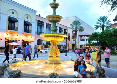 West Palm Beach, FL/ USA 07/29/2017- Visitors enjoy a pleasant evening by the fountain in West Palm Beach's Cityplace.