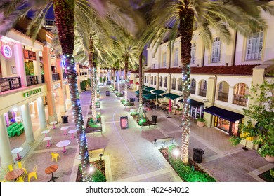 WEST PALM BEACH, FLORIDA - APRIL 3, 2016: Palm trees line the mixed-use development CityPlace at night.